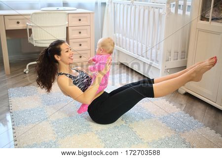 Mother shaking the press with the baby in her arms