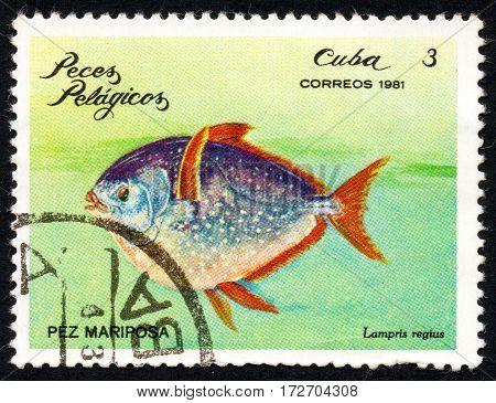 UKRAINE - CIRCA 2017: A stamp printed in Cuba shows a Butterfly fish Lampris regius the series Pelagic Fish circa 1981