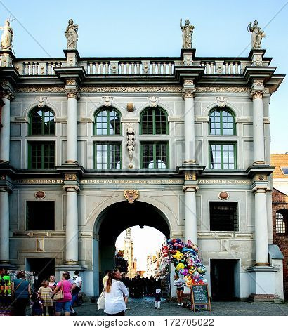 Gdansk Poland - July 18 2014: Golden gate on Dluga Street in the old city center. Stone figures represent allegories of citizen's virtues: Caution Justice Piety and Concord. The most visited tourist destinations.
