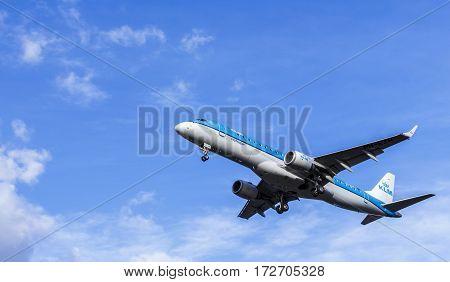LONDON, UK - CIRCA 2015: KLM Embraer ERJ-190 Passenger Aircraft landing approach