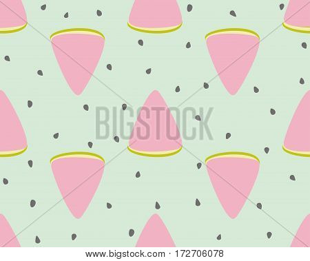 Slices of watermelon and seeds on a green background