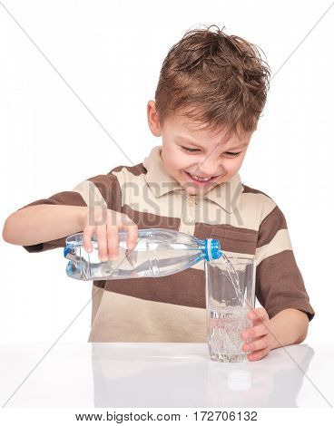 Portrait of cheerful little boy with glass and plastic bottle of water. Cute smiling child drinks water, isolated on white background.