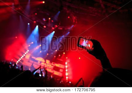 Hand With A Smartphone Records Live Music Festival, Taking Photo Of Concert Stage