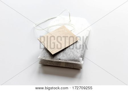 Close up lable of teabag with black tea on white table background mock-up