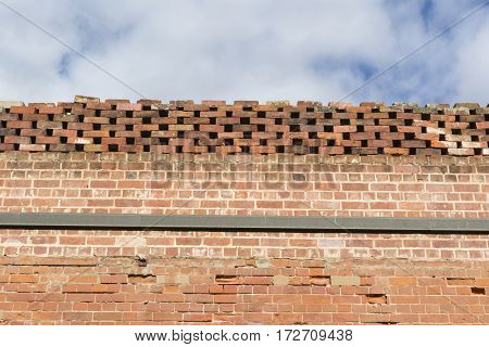 Red Bricked With Honeycombe Topped Wall