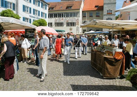People Walking And Shopping At The Market Of Ueberlingen