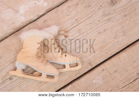 Wooden decoration skates on a scaffolding wood