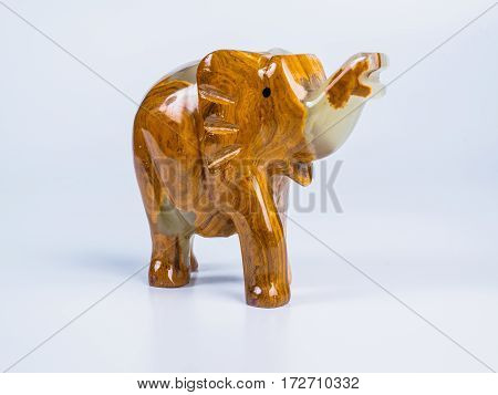 Picture of the onyx elephant on white background. Side view.