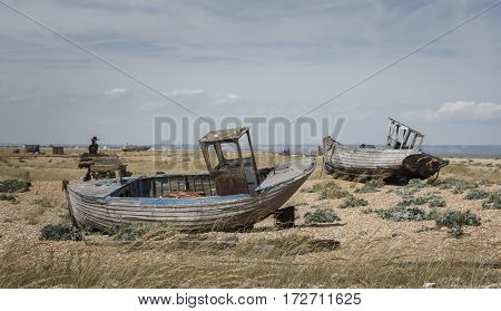 Old abandoned boats washed up on a beach