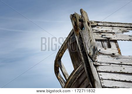 Close up of the front of an old abandoned boat