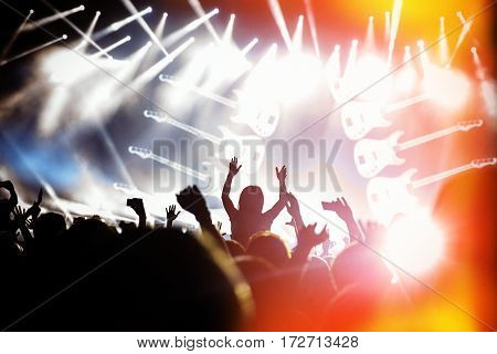 Silhouettes Of Concert Crowd In Front On Bright Stage Lights