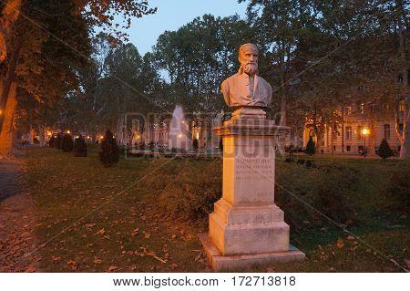 ZAGREB, CROATIA - OCTOBER 14, 2016: Bust of August Senoa, a Croatian novelist, critic, editor, poet, and dramatist. Located at Josip Juraj Strossmayer Square. Night time, darkness