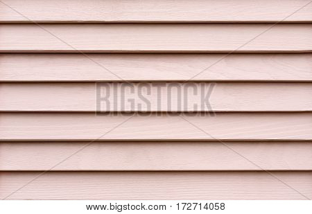 Pastel pink wood planks. Kiln dried wooden lumber texture background. Painted pine furniture surface. Timber hardwood wall. poster