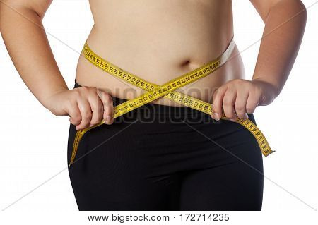Fat Woman Measuring Her Waist With A Yellow Measuring Tape. Reduction Of Overweight And Obesity Trea