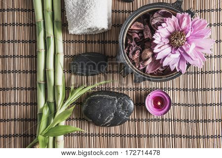 spa still life with zen basalt stones ,votive candle and bamboo