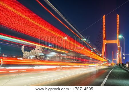 traffic on bridge at night in Nanchang city,China.