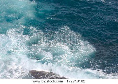 Waves hitting the sea shore cliffs