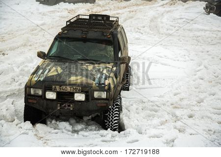ALMATY, KAZAKHSTAN - FEBRUARY 21 2013: Off-road racing on jeeps Car competition ATV. Traditional race