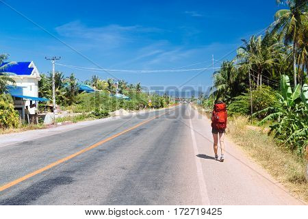 lonely girl is hitchhiking on the road Cambodia