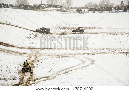 ALMATY KAZAKHSTAN - FEBRUARY 21 2013: Off-road racing on jeeps Car competition ATV. Traditional race