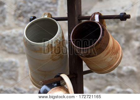 Ceramic mugs / Ceramic ware hanging on the hanger