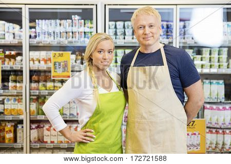 Workers Wearing Aprons While Standing In Grocery Store