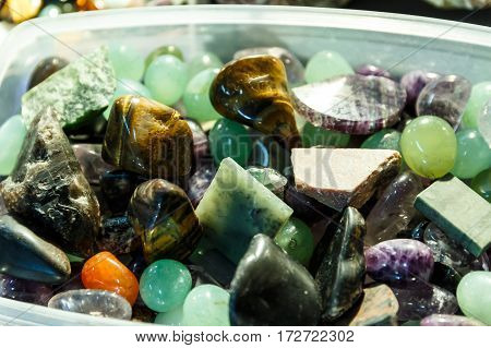 rare gems and minerals on a shelf in a souvenir shop and magic