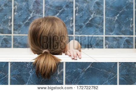 Little girl taking a bubble bath. Healthcare and hygiene concept.