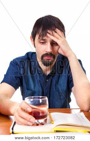 Sad Student with Alcohol on the Desk Isolated on the White Background