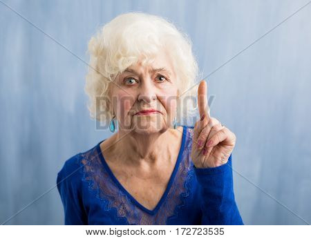 Angry and disappointed Grandma holding her finger up
