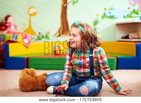 Cute Happy Girl Playing In Kindergarten For Kids With Special Needs