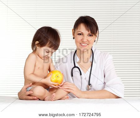 Doctor pediatrician with a young girl in his office
