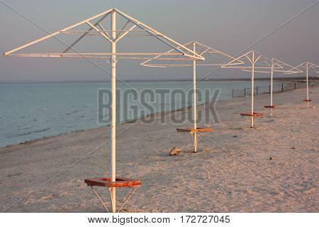 Beach umbrella On Sandy Sunset Beach. Sky. Background