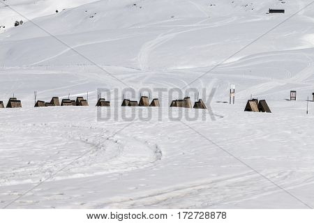 view of the casitas for dogs in snow