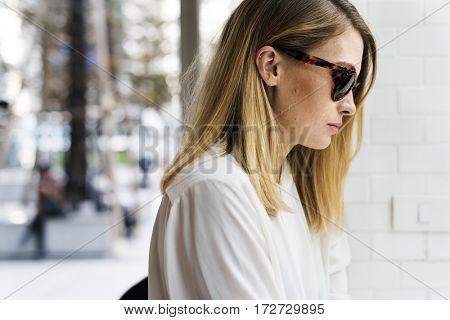 Women Sitting Thinking Alone Outdoors