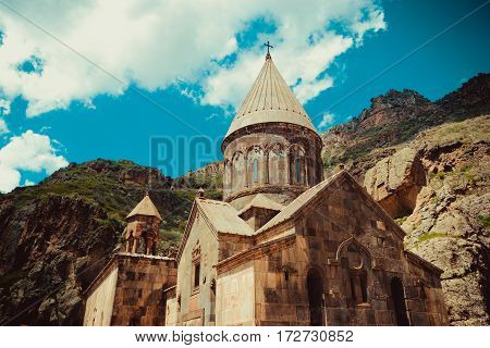 Photo of the Geghardavank or Geghard monastic complex is Orthodox Christian monastery located in Kotayk Province, Armenia. Armenian architecture. Pilgrimage place. Religion background. Travel concept poster