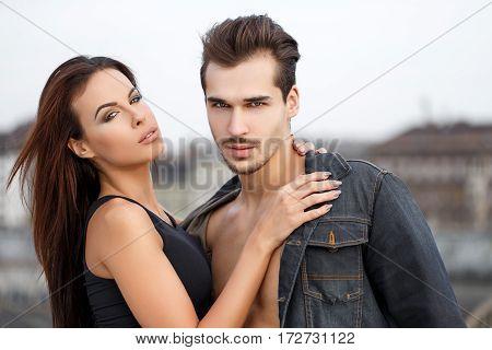 Sexy trendy man with girlfriend outdoor portait