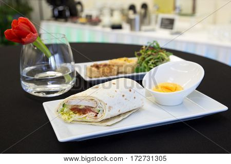 Chicken Tortilla Wrap With Dip And Two Quiches On Modern Plates.