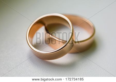 Wedding rings on a white background, wedding bands, infinity sign of the wedding rings on white