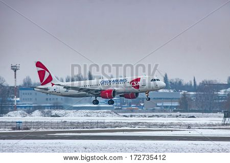 Borispol Ukraine - January 6 2011: Czech Airlines Airbus A320 landing on a cold winter evening