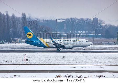 Borispol Ukraine - January 6 2011: Ukraine International Airlines Boeing 737 landing on a winter evening