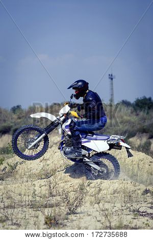 Racing Enduro motorcycle on a dirt track on a sunny day.