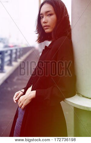 Young asian woman portrait on the bridge
