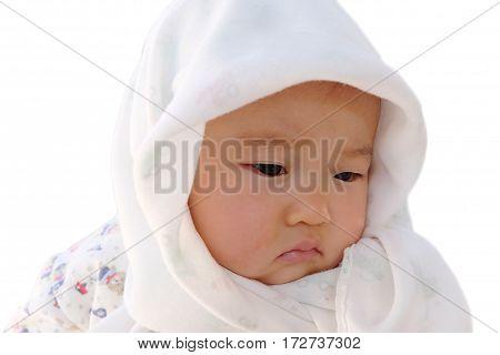 Sad baby under the hood isolated on white.