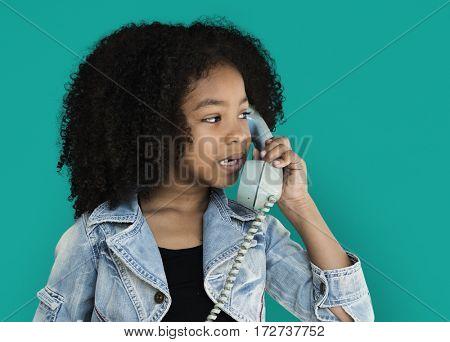 Little Girl Talking on the Phone Communication Studio Portrait