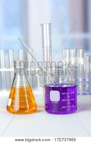 Laboratory glassware on white table