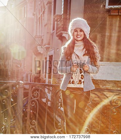 Smiling Tourist Woman In Venice, Italy In Winter Writing Sms