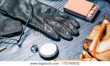 Set of fall womens accessories with sunglasses, leather gloves and matches
