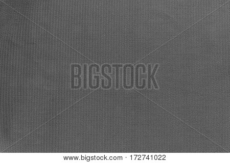 texture and background of synthetic fabric of gray black color with a small chess pattern