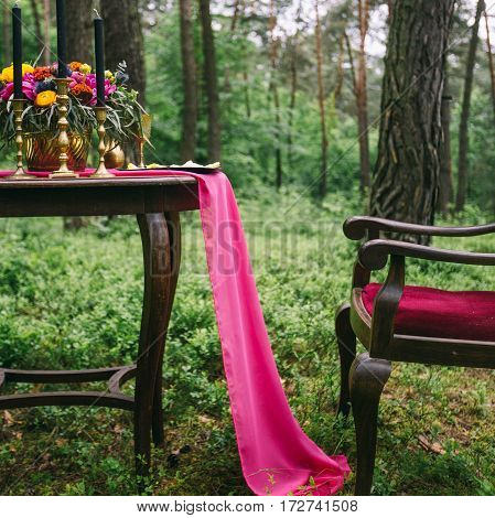 Close Up Of White Vintage Candelabrum On The Wedding Decorated Table In The Forest. Bouquet Of Pink